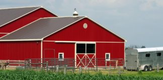Replace the wooden barn with gable roof metal barn