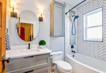 oval mirror near toilet bowl 1910472 1